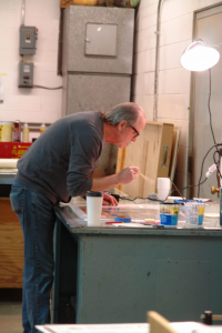 Photo of T. L. Solien in the Studio